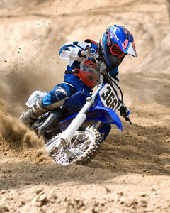 dirt bike riding on sand